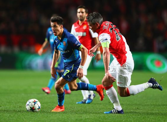 Alexis Sanchez of Arsenal takes on Jeremy Toulalan of Monaco during the UEFA Champions League round of 16 second leg match between AS Monaco and Arsenal at Stade Louis II on March 17, 2015 in Monaco, Monaco.
