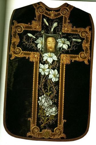 Chasuble made by St. Thérèse. The chasuble itself was made from an old dress of Madame Martin's. It appears to be a heavy brocade type fabric. It is dark green in colour. St. Therese painted the Holy Face and the vines and roses. Wow! Not only was the Little Flower so holy, she was so talented, too!: