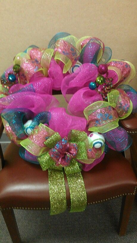 Pink, turquoise & lime green Christmas wreath. Love the colors!