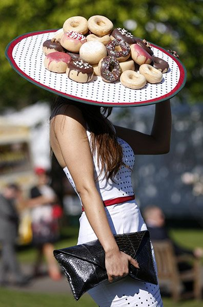 This year's most-photographed novelty hat: the doughnut platter   Photograph: Tim Hales/AP: