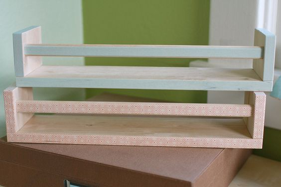 Ikea spice racks (bookshelves) with the edges covered in washi tape