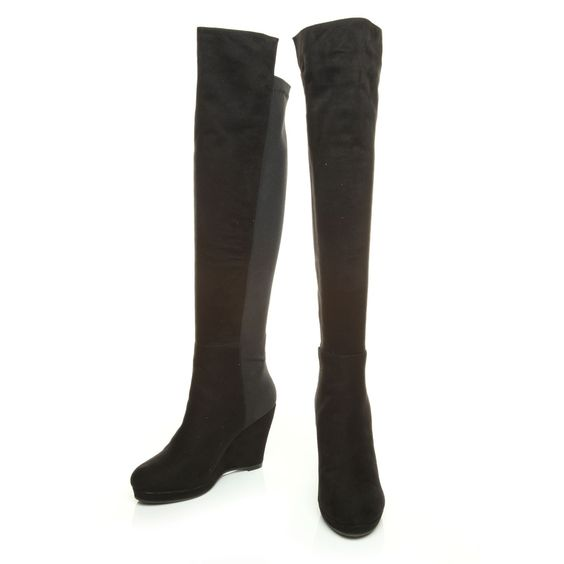 Black pull on thigh high boots that have a stretch back so they