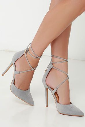 "Your rise to stardom begins with signature looks like the Leading Role Grey Suede Lace-Up Heels! Soft vegan suede composes a split, pointed-toe upper with a high-rise heel back. Crisscrossing laces wrap around the ankle and are finished in shiny gold aglets. 4.5"" wrapped stiletto heel. Cushioned insole. Rubber sole has nonskid markings. Available in whole and half sizes. Measurements are for a size 6. All vegan friendly, man made materials. Imported."