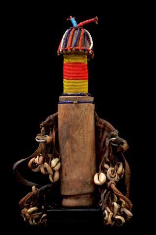 Large doll, Namchi (or Dowayo )people, Cameroon. Wood, kauri shell, metal, glass beads, human hair.
