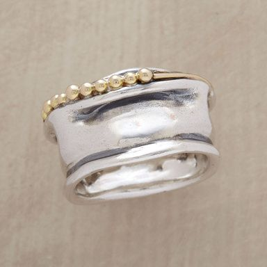 """MUSEO RING -- Sculpture to wear, the wavy convolutions of hand cast sterling silver are overlaid with a beaded ribbon of 14kt gold. A Sundance exclusive in whole sizes 5 to 9. 1/2""""W."""