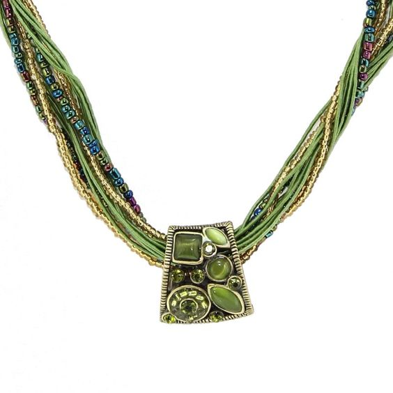 This green stone necklace is sure to draw attention. Featuring multiple beaded strings and a gorgeous beaded pendant, this handmade piece is durable and will enhance any casual or formal look. Its lobster-claw clasp keeps it secure during wear.