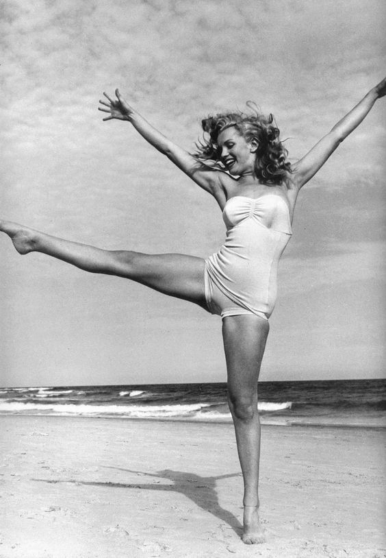 Marilyn Monroe, June 1949   i love this photo because of the happy and carefree vibe, and her body is perfect as it is: