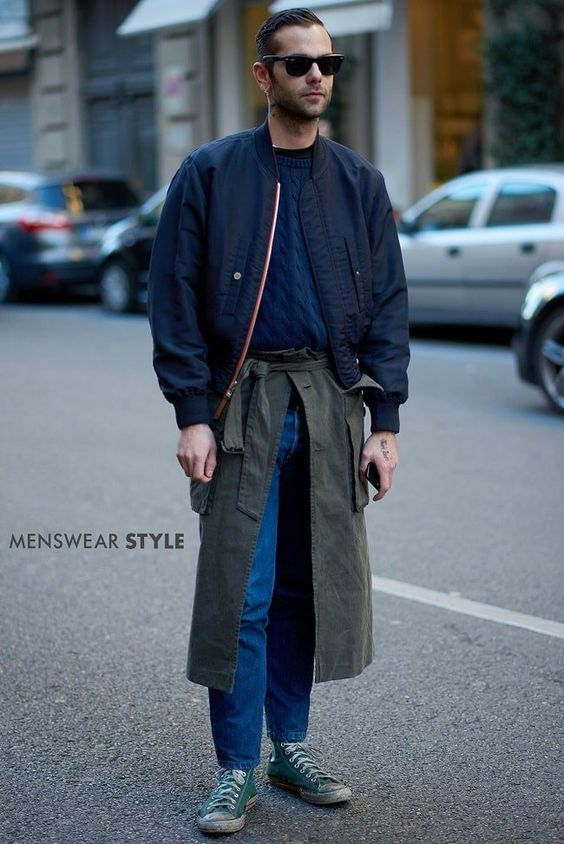 This stylish chap is wearing Green Converse, Olive Kimono, Navy Flight Jacket and Black Wayferers on the streets of Milan.