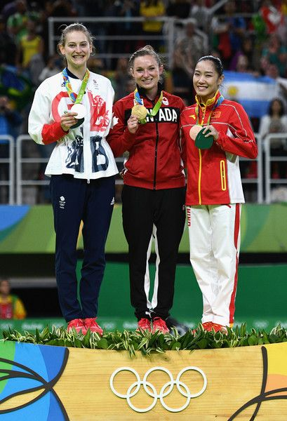 Silver medalist Bryony Page of Great Britain, gold medalist Rosannagh Maclennan of Canada and bronze medalist Dan Li of China pose during the medal ceremony for the Trampoline Gymnastics Women's Final on Day 7 of the Rio 2016 Olympic Games at the Rio Olympic Arena on August 12, 2016 in Rio de Janeiro, Brazil.