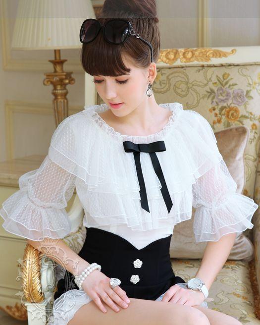 Blusa Blanca de olanes con liston negro