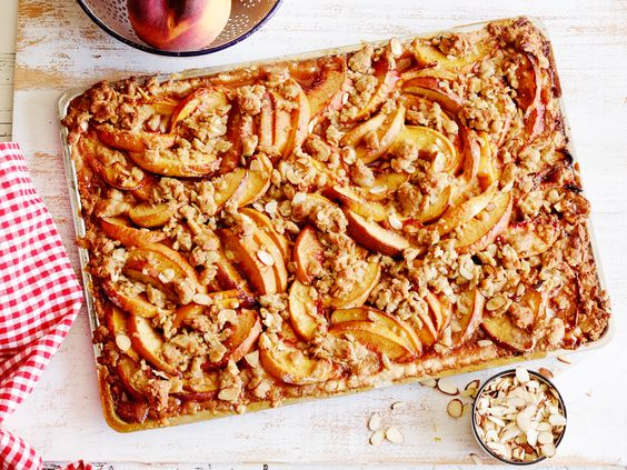 Peach Streusel Slab Pie : This slab pie starring summer's sweetest fruit is the simplest of the bunch, since you don't even have to roll out the dough. The press-in dough (reminiscent of shortbread) is super-easy to make and saves lots of time. For something a little different, substitute pecans or skinned hazelnuts for the almonds in the streusel topping. via Food Network