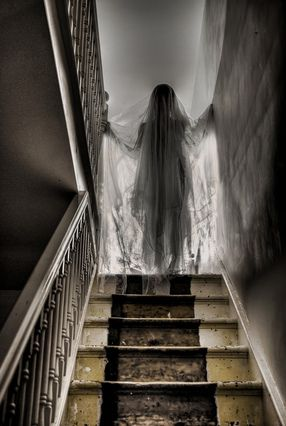 Use a mannequin or a sewing form with a styrofoam wig head covered with dark fabric and then draped in tulle or gauze positioned at the top of the stairs if you don't want guests going up there during your Halloween Party.: