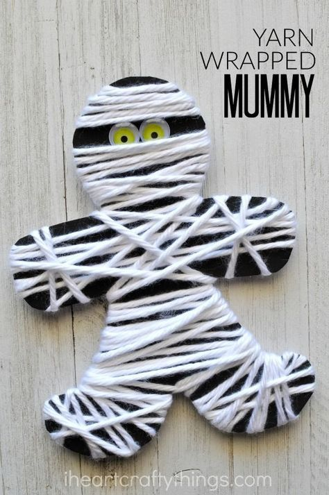 This yarn wrapped mummy craft is perfect for little ones for a fine motor activity. It makes a great Halloween kids craft too.