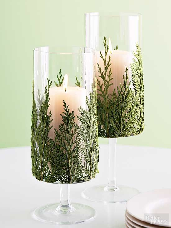 Let the winter greenery creep into this clever candle display. Start with a glass votive, wineglass, or hurricane as the candleholder. Choose a flat pine needle branch like the fragrant arborvitae. Apply spray adhesive to one side of the greenery and press firmly onto the glass. Clip off loose pine ends if needed./