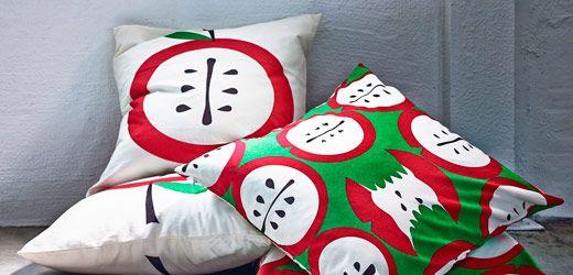 Pudebetræk liamaria med æbler i rød og grøn. skab en hyggelig ...