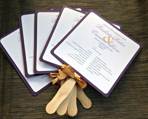 Dark purple program fans embellished with a gold ribbon #programfan #wedding #purple #gold #customprogramfan