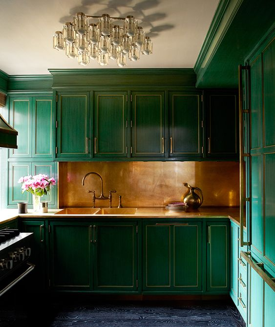 Cameron Diaz's Green NYC Kitchen. The light fixture is also pretty spectacular.