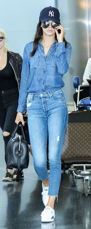 Kendall Jenner arriving at JFK in New York (May 3, 2015), wearing a New Era 9Fifty New York Yankees Cap, a Rails Carter Dark Vintage Wash Button Down Shirt, a Givenchy Lucrezia Mini Leather Bowling Bag, MOTHER Stunner Ankle Fray Jeans in Graffiti Girl and Puma 'Match Lo – Basic Sport' Leather Sneakers. #kendalljenner #style