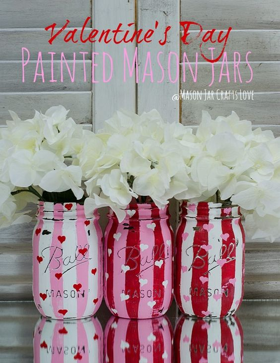 Valentine's Day DIY Mason Jars in stripes of pink, white and red adorned with hearts!