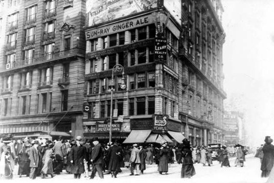 "( Macy*s ) Photo shows an old street scene at 34th street and Broadway in New York City. Photo dates to winter of 1911. Nice view of old shops, buildings, and other period interest. Titled: ""Million Dollar Corner - small plot of land that sold for a million dollars.:"