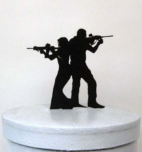 Hey, I found this really awesome cake topper at https://www.etsy.com/listing/203200035/wedding-cake-topper-rifle-gun-wedding