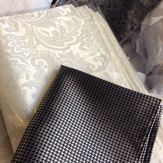 A batch of beautiful white new paisley pocket squares for the groomsmen and a dapper houndstooth for the groom!
