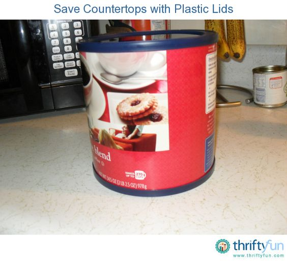 When I open  a new can of coffee, I take the plastic  top from the old can and put it on the bottom of the new can.  The plastic will help to protect your countertops.