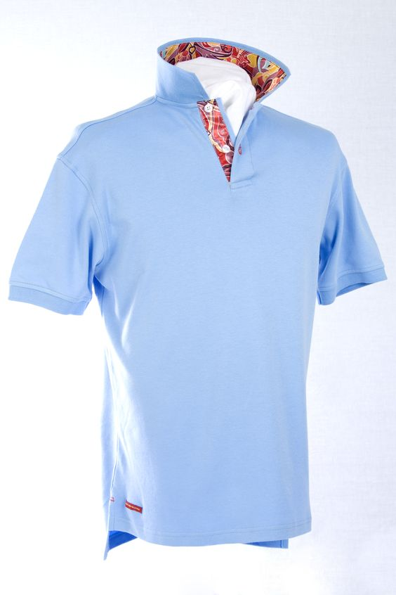 Our classic-fitting short-sleeved polo in breathable cotton interlock, finished with captivating Robert Owen Collection signature flag.  Color: Sky Blue  Collar: (Multiple Colored Spiral Satin Print)  Two-button concealed twill placket, contrasting twill collar. Collar topside has fashionable print similarities of placket. Our signature Robert Owen Collection flag label, accents the lower right. Accompanied by matching handkerchief. 100% cotton. Machine washable. Imported.  $70.00