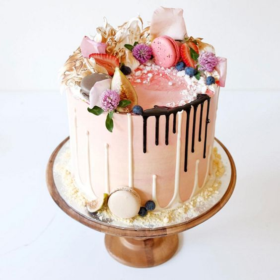 The drip cake is one of the most popular new wedding trends for for the year ahead and this sweet number gets bonus points for its double drip effect.: