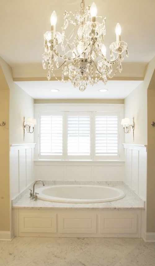 Windows with plantation shutters next to a huge bathtub for Master bath windows