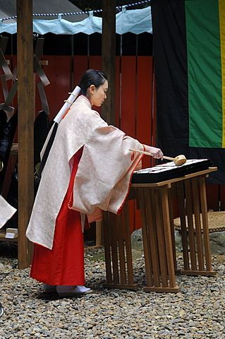 Shrine maiden dividing the holy sake, rice wine, which every participant of the procession from the Shimogamo shrine to the Mikage shrine receives, Kyoto, Japan, Asia