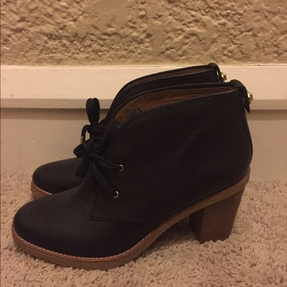 Coach booties How stunning are these black leather coach booties?! They are in perfect condition other than the small blemish on one heel. They lace up the front and have a cute gold detail on the back. Super chic with any look! #booties #euc #coach #cute #black #leather #gorgeous #boots Coach Shoes Ankle Boots & Booties