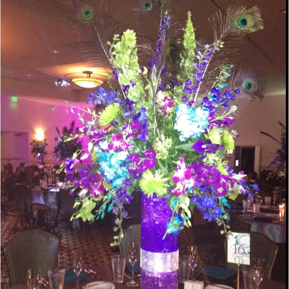 Peacock colors for flowers from our wedding tonight---purples and greens