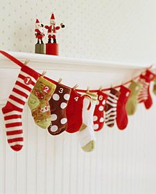 baby sock advent calendar - totally useful for all the single socks from the kidlets.  Fill with small candies or chocolates, dollar store toys (but try to avoid junky ones that will just create clutter), hair ribbons/clips, etc.  WAY more realistic I'll do this one than the pocket sewing ones I've seen.