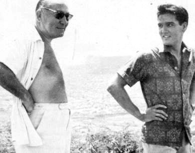 Elvis and Producer Hal. B Wallis in april 17 1961 on the movie set Blue Hawaii .