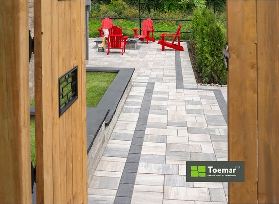 What goes best with red Muskoka chairs? a) Beer b) A fabulous patio from Toemar c) Good friends on a summer afternoon d) All of the above #dreampatio #patiostones #backyarddesign #mississaugagarden