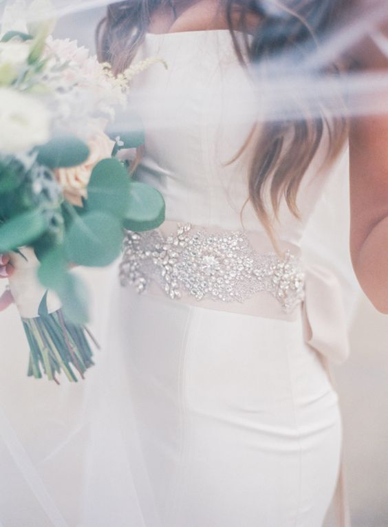 Embellished ribbon added to a chic Carolina Herrera wedding dress: http://www.stylemepretty.com/ohio-weddings/cleveland/2016/09/06/they-met-at-work-and-the-rest-is-totally-stunning-history/ Photography: Lauren Gabrielle - http://laurengabrielle.com/