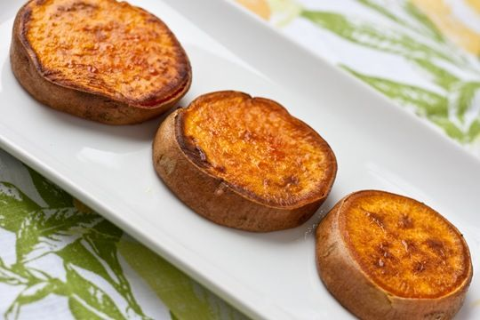 "Sweet potato: Preheat oven to 350*  Slice sweet potatoes ~1/2"" thick  Lightly coat with olive oil + a sprinkling of salt  Bake for 20min [turning once]  Turn heat to 400*  Bake for ~15-20min more [turning once]  You won't even believe what you have just done.  As you puncture through the slightly crunchy browned skin, the center oozes with creaminess.  It is like you puree'd sweet potatoes and infused them back into the potato."