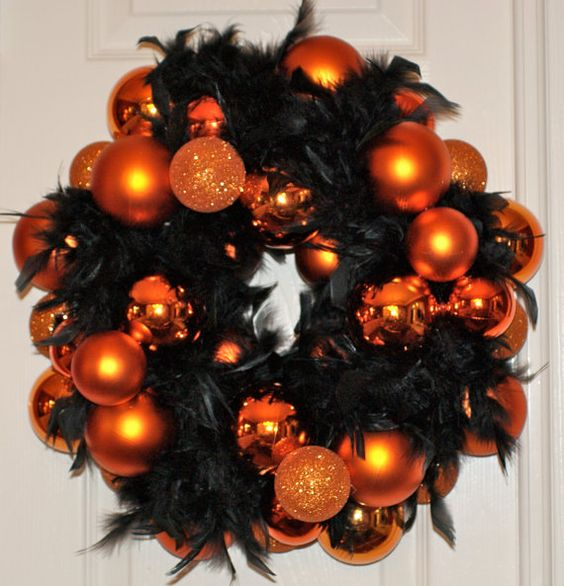 with Orange glass bulbs, black boa. Gorgeous Halloween wreath! I might do this with some other colors! it's cute!
