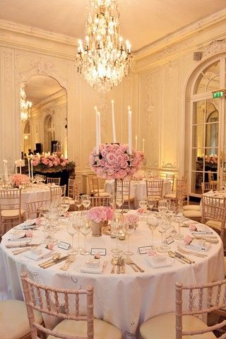 For a timeless wedding theme, choose domes of roses in oversized silverware. Team with candlesticks to balance the look.