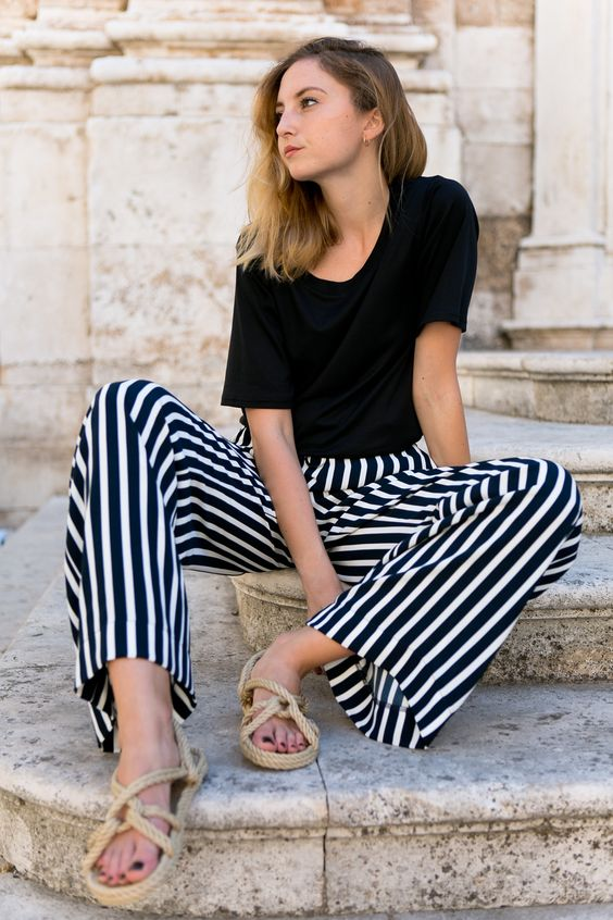 Wearing Moye cotton t-shirt, Echo striped pants, Totême sandals, Apart earrings and Chanel (#526 Cavaliere) nailpolish
