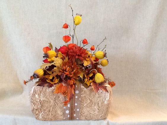 Arrival of Fall - Beautiful colorful fall arrangement sitting atop a 8x14 bale of straw.  Rustic yet elegant to brighten any decor style. on Etsy, $36.96