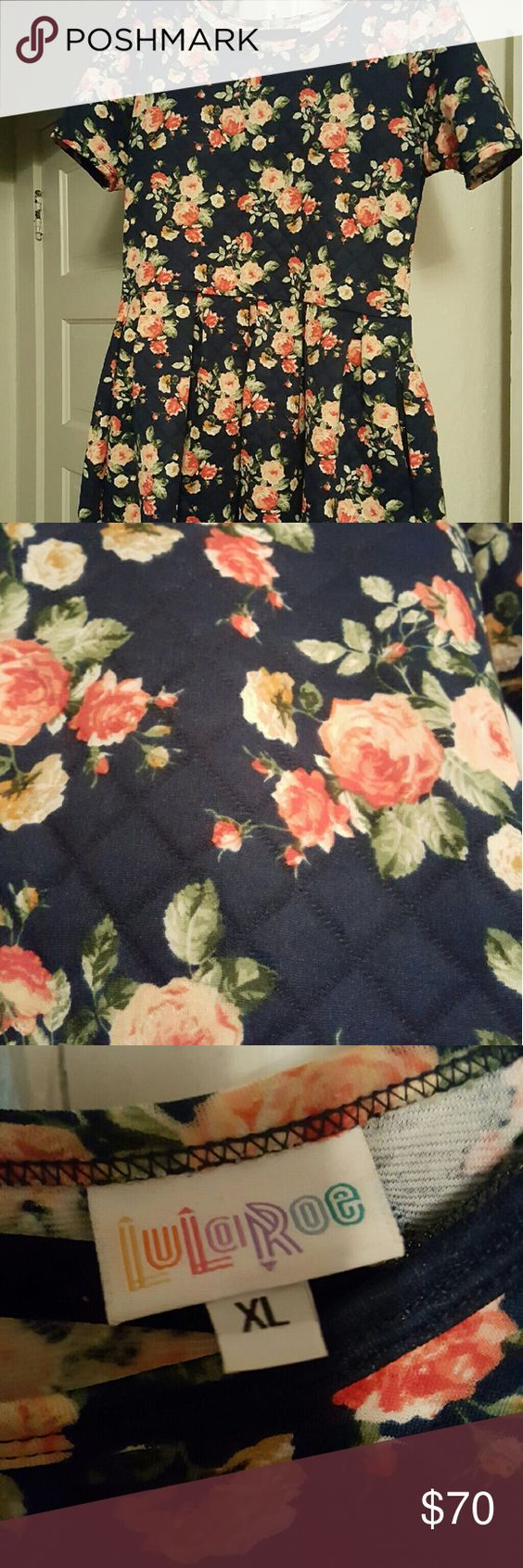 Beautiful floral dress! LuLaRoe Amelia dress! So pretty, I'm tempted to keep it. Navy background. Quilted texture (see photo). True to size. LuLaRoe Dresses Midi
