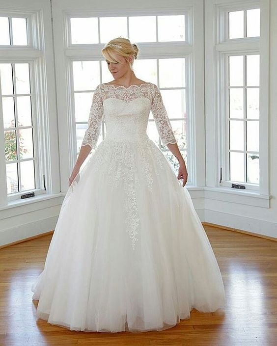 Modest wedding dresses for the plus size bride are common. Most brides prefer to cover up parts of their body.  This illusion neckline style wedding gown has sheer lace sleeves as well. You can find #plussizeweddingdresses like this on our site. They can be made with any changes. We can also replicate any dress from a picture and use it as inspiration to make your custom gown.  get pricing on #weddinggowns and replicas when you contact us directly from our website.