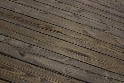 Power washing and sanding will restore an old deck surface.