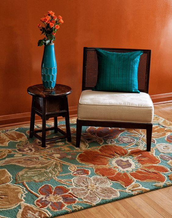 Burnt orange jaipur and deep sea on pinterest for Coral teal and brown living room