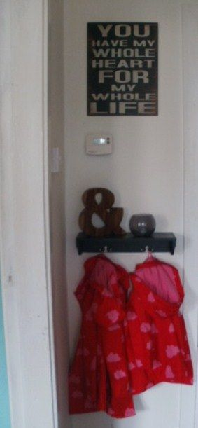 Cute little entry shelf for kids coats, and metal wall art: Everlasting Home Blog