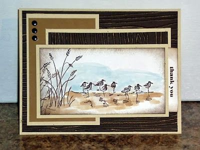 """By Heidi Weaver. Uses Stampin' Up """"Wetlands"""" stamp set. Used water brush with ink on pad lid for sand and water. Sponged edges. Sanded dry-embossed background panels to bring out the wood grain."""