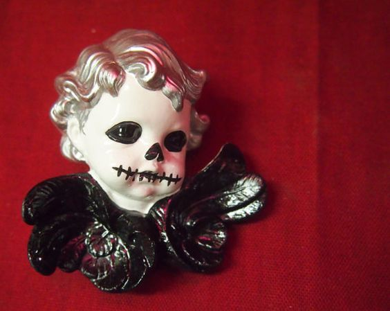 Hey, I found this really awesome Etsy listing at https://www.etsy.com/listing/166231942/creepy-angel-ornament