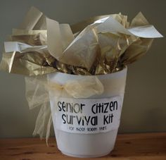 Fun retirement gift or birthday party present: Senior Citizen Survival kit with energizer batteries, Act 2 popcorn, socks to kick up your feet and more.